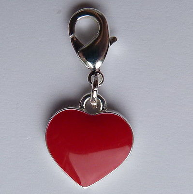 Clip on charm for bracelet or hand bag. Red heart with silver backing.