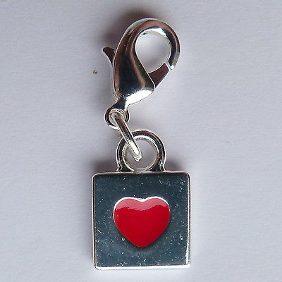 Clip on charm for bracelet or hand bag. Silver square with red heart.